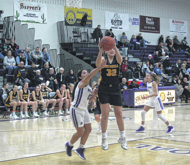 Hadley Galvan of Archbold with a rebound Friday night at Swanton in NWOAL play. The Blue Streaks bested the Bulldogs, 45-34.
