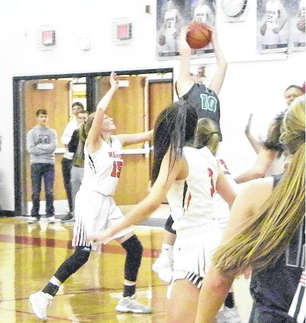 Delta's Brooklyn Green (10) pulls down a rebound with a host of Wauseon defenders surrounding her Friday night in a league contest. The Panthers bested the Indians 74-41.