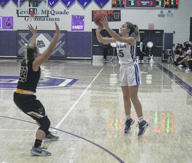 Frankie Nelson of Swanton fires up a three-pointer during Tuesday's non-league matchup with Pettisville. She helped the Bulldogs' cause with 10 points, as they defeated the Blackbirds 61-45.