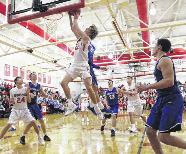 Connar Penrod of Wauseon draws a foul on a layup attempt Saturday versus Anthony Wayne in non-league boys basketball. The Indians held off a couple of second half rallies from the Generals to win 69-61.