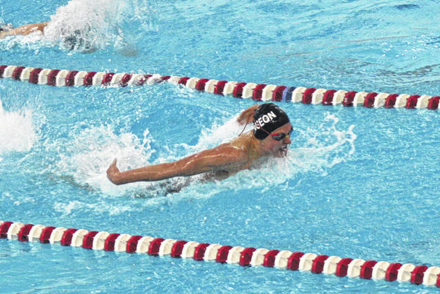 Ryan Scherer of Wauseon swims in the 100-yard butterfly at an earlier meet this season. This past weekend at the NWOAC Championships in Fremont, he placed third in this event.