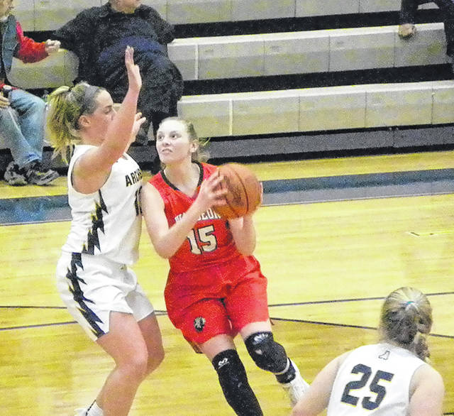Marisa Seiler of Wauseon drives into Andi Peterson of Archbold Friday in NWOAL girls basketball. Archbold held off a late rally from the Indians, winning by a final of 55-48.