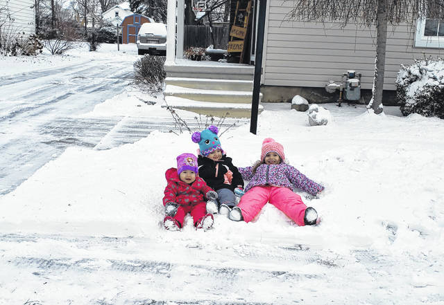 The first notable snow of the season fell Saturday throughout Fulton County. Around 1-3 inches of snow was reported. Above, Julianne, Claudia and Kinsley Schmucker enjoy the snow in Wauseon.
