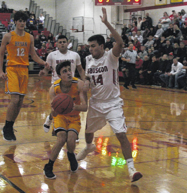 Wauseon's Noah Tester with good defense on Connor Shirkey of Bryan during Friday night's Northwest Ohio Athletic League contest. The Indians overcame a halftime deficit for a 40-35 win over the Golden Bears.