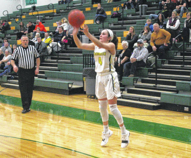 Savannah VanOstrand of Evergreen with a three-pointer Thursday versus Swanton in NWOAL girls basketball. The Vikings downed the Bulldogs, 59-48.