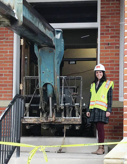 Toni Schindler, marketing and communications director for the Fulton County Board of Commissioners, inspects renovation work at the county courthouse. County Administrator Vond Hall said starting the upgrade was one of the county's top achievements in 2018.