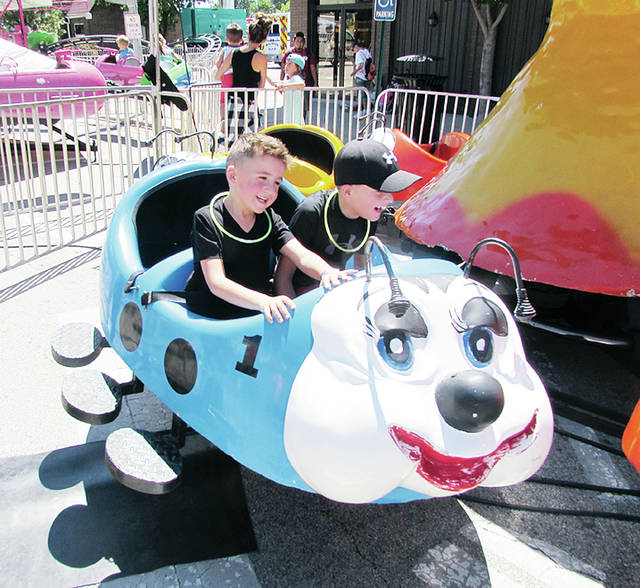 Kids enjoy a ride at the 2018 Homecoming. This year's event has been moved to June due to a broken contract with the event's longtime amusements provider.