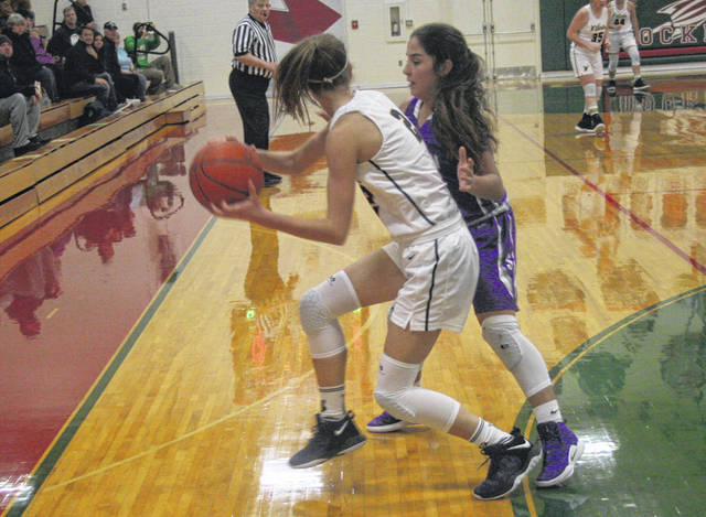 Aricka Lutz of Swanton, right, guards Ava Beam of Woodmore in the backcourt during a Division III girls basketball sectional semifinal Tuesday. The Bulldogs fell to the Wildcats by a 53-42 final.
