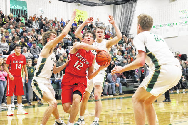 Trent Armstrong of Wauseon drives into the teeth of the Evergreen defense during Friday's NWOAL contest. The Indians got out to a fast start and never looked back, hammering the Vikings 66-43.