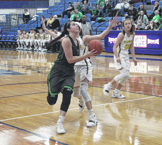 Brooklyn Green of Delta heads to the basket during Saturday's Division III sectional final against Evergreen. She finished with 10 for the Panthers who routed the Vikings, 63-33.