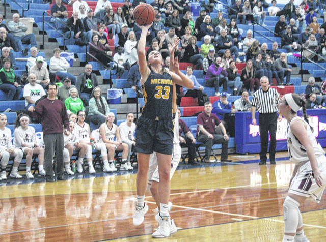Lily Krieger of Archbold scores a bucket inside versus Rossford Saturday in a Division III sectional final at Springfield. However, the Blue Streaks let a lead slip away as they fell to the Bulldogs 58-54 in overtime.