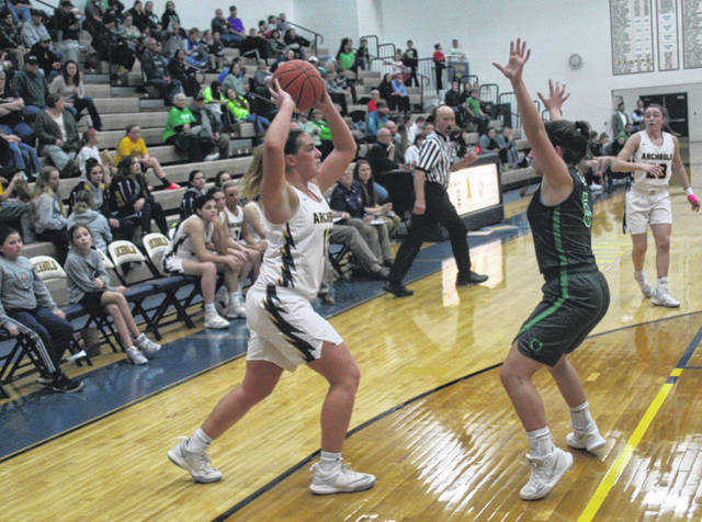 Andi Peterson of Archbold looks to pass the ball during a NWOAL game with Delta Thursday. The Blue Streaks handed the Panthers their first league loss, winning by a final of 54-44.