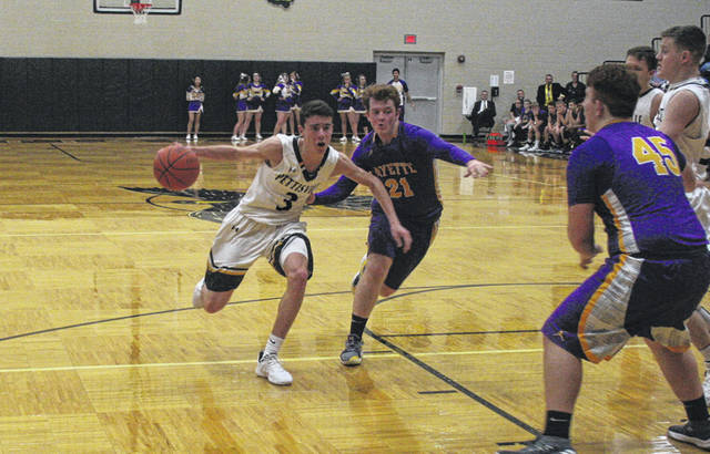 Logan Rufenacht of Pettisville looks to drive the middle of the lane while Porter Maginn (21) defends for Fayette during Friday's BBC boys basketball contest. The Blackbirds doubled up the Eagles in the second half for a 59-43 win.