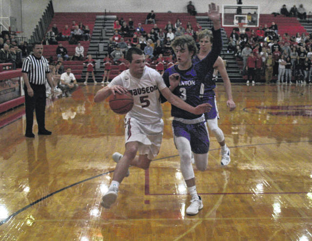 Levi Seiler of Wauseon drives on Josh Vance of Swanton during a NWOAL boys basketball game this season. Seiler received player of the year honors in the league.