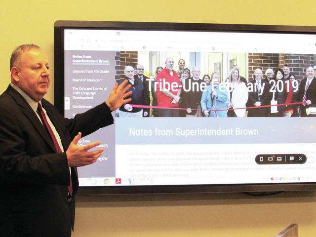 Larry Brown, Wauseon schools superintendent, displayed the new look of the school district's newsletter, The Tribe-Une, at Monday's Board of Education meeting.
