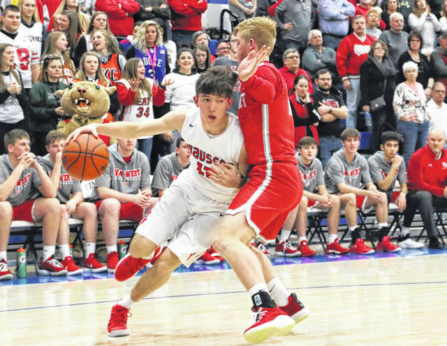 Trent Armstrong of Wauseon drives to the hoop during the sectional final versus Van Wert Friday night. The senior closed his career with 20 points in the Indians' loss to the Cougars.
