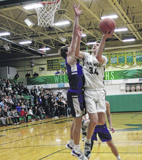 Nate Brighton of Evergreen goes to the bucket as Randy Slink of Swanton defends on Friday in the sectional final.