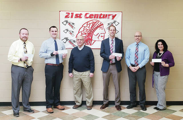 The Wauseon Rotary Club recently presented $1,000 to each of the Wauseon school district's principals. The Rotary has encouraged them to use the funds for student field trips, most notably to the Museum of Fulton County. In past years, the schools have used Rotary Club donations to support the elementary school food pantry and the district's service dog. Pictured are, from left, Joe Friess, middle school; Blake Young, primary school; Rotary Club President Bill Drummer; Keith Leatherman, high school; Ryan O'Dell, high school assistant principal; and Theresa Vietmeier elementary school.