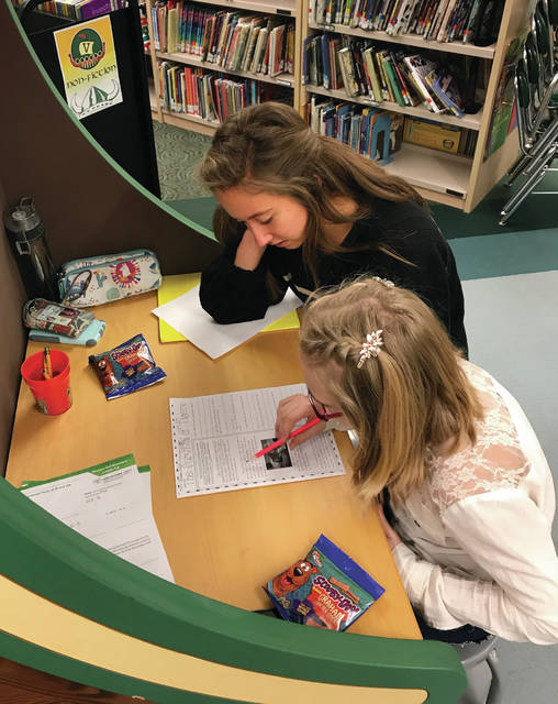 Evergreen High School tutors have been working with younger students on various assignments.