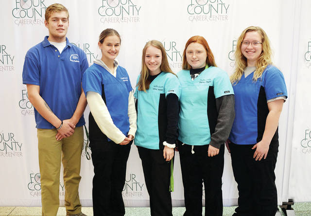Twenty-six Health Occupations Students of America (HOSA) chapter members at Four County Career Center in Archbold have qualified for State HOSA Skill competition in Columbus April 9-10 by placing in the top five in the regional contests. Winners from Fulton County are - front, from left - Shawn Pedersen of Delta, Kayla Dusek of Archbold, and Adriel Nelson, Sierra Gault, and Morgan Todd, all of Wauseon. Absent: Zoey Rauch of Evergreen. HOSA members from all parts of Ohio will compete for awards and the right to advance to national skill and leadership contests. HOSA Advisors are Donna Badenhop, Robin Hill, Karen Walker, and Mike Nye.