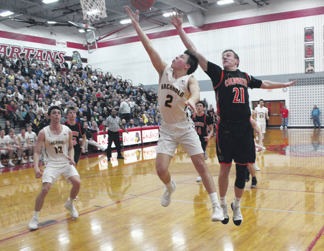 Archbold's A.J. Mahnke lays one in Thursday versus Coldwater in a Division III district semifinal at Lima Senior. The Blue Streaks allowed a rally late from the Cavaliers, falling by a 35-34 final.
