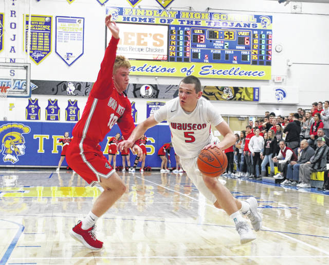 Levi Seiler of Wauseon drives on a Van Wert defender during a Division II sectional final. He was named the Division II Player of the Year by the District 7 Coaches Association.