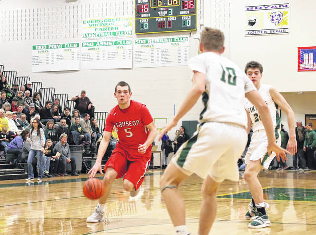 Levi Seiler of Wauseon advances the ball upcourt in a game at Evergreen this season. He was recently selected first team All-Northwest District in Division II.
