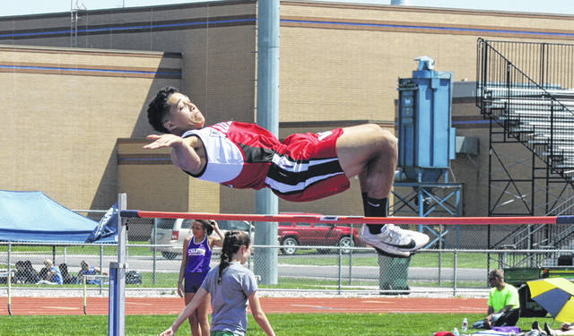 Wauseon's Xavier Torres clears the bar in the high jump last season during the NWOAL Track and Field Championships. Torres won the title and was also league and a regional qualifier in the long jump for the Indians.