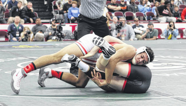 Xavier Torres of Wauseon, top, looks to score points in the Division II 170-pound final against Lucas Salmon of Sandusky Perkins Saturday.