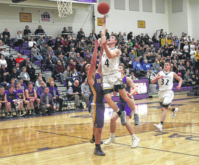 Detric Yoder of Pettisville floats one into the basket Friday in the sectional final versus Fayette Friday at Bryan. The Blackbirds bested their rival by a 69-51 final.