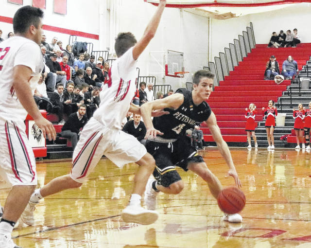 Detric Yoder of Pettisville handles the ball in a game at Wauseon this season. He was named first team All-BBC for the Blackbirds.