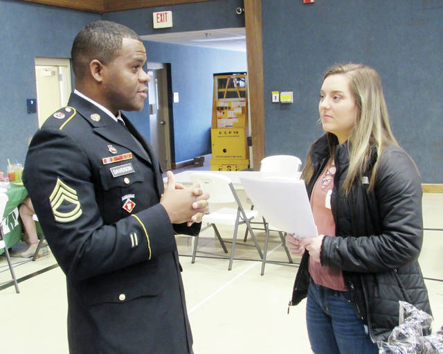 Sgt. First Class Recardo Davidson of the U.S. Army talks to Wauseon High School senior Rylee Wreede about a military career at the FCEDC Career Exploration Day.