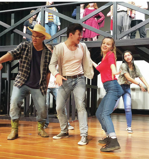 """Footloose"" cast members, Uzziah DeLaCruz, Christian Cantu and Monica Betz rehearse for Wauseon High School's production this weekend."