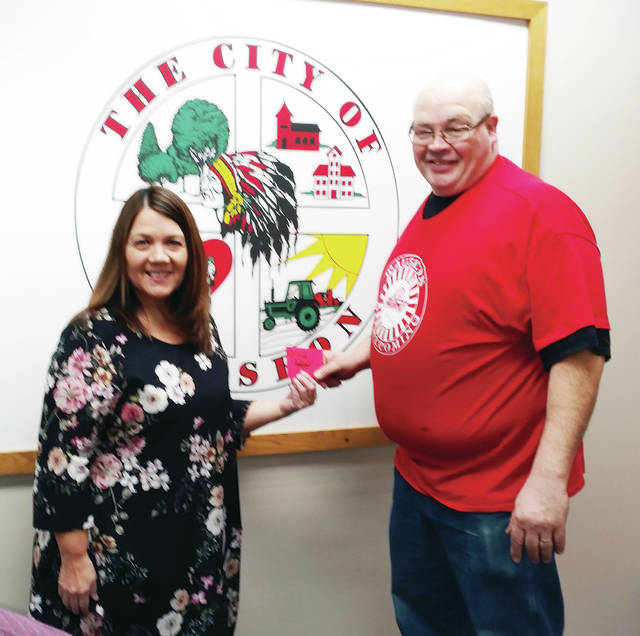 Wauseon Mayor Kathy Huner bought ticket No. 1 from Homecoming Chairman Keith O'Brien to kick off the 2019 Wauseon Homecoming raffle ticket sales. From March 1 through April 12, tickets can be purchased from any Wauseon High School or junior high band member or choir member. After April 12, tickets can be purchased from any Wauseon Homecoming Committee member. Tickets are one for $5,; three for $10; and seven for $20. The grand prize is $10,000; second prize, a custom golf cart; third prize, a 50-inch flat screen television; fourth prize, a Weber gas grill; fifth prize, an IPad; sixth prize, a Fulton County Fair package; and seventh prize, $100.