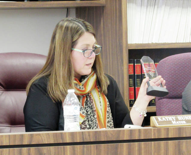 At Monday's City Council meeting, Wauseon Mayor Kathy Huner displayed a Heart Beat Award from the Chamber of Commerce in recognition of the new city pool.