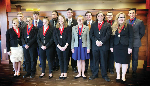 The Wauseon High School Speech and Debate team includes - front, from left - Maggie Carder, Kamron Goolsby, Olivia Gigax, Faith Stinner, Emily Hoeffel, Quintin Gigax, Anias Thompson - back, from left - Reece Mealer, Chase Mattin, Alex Guerrero, Noah Harman, Hunter Mattin, Jeb Reeves, Christian Cantu.
