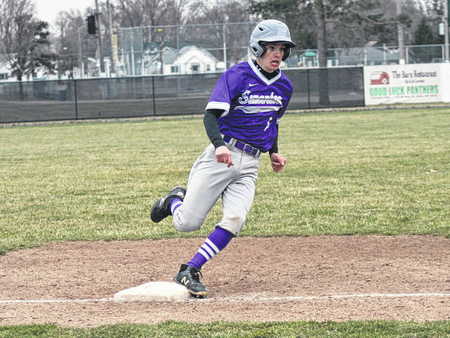 Swanton's Tommy Chonko rounds third as he looks to score in the top of the fourth inning Thursday versus Delta. The Bulldogs used a nine-run sixth to take down the Panthers 12-2 in six innings.
