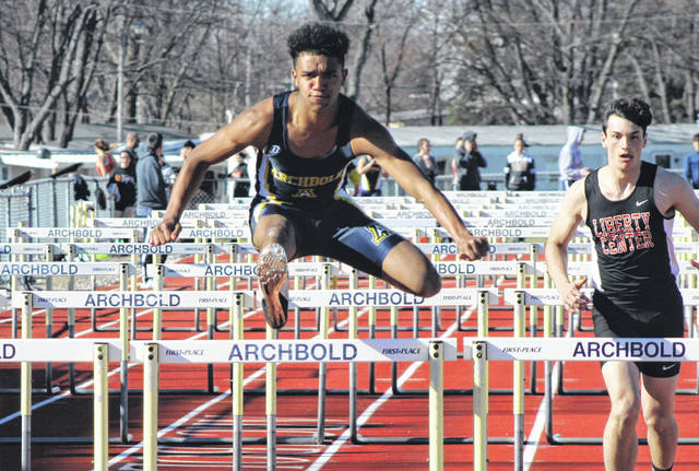 Antonio Cruz of Archbold clears the last hurdle in the boys 110 meter hurdles during a NWOAL tri-meet with Liberty Center and Delta Tuesday. He placed first in this event with a time of 17.6.