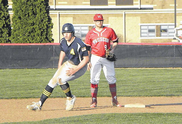 Cory Erbskorn of Archbold rounds second base in front of Wauseon's Levi Krasula during Monday's NWOAL baseball game. The Blue Streaks scored 13 runs on 16 hits as they defeated the Indians 13-4.