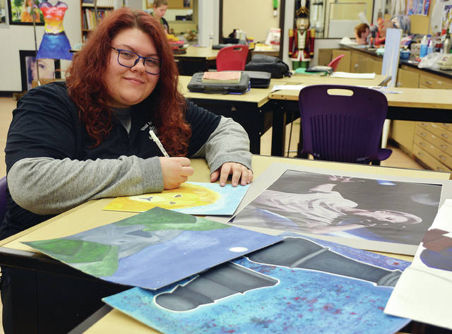 Four County Career Center in Archbold invites the public to the annual Art Show on Thursday, April 25, 10 a.m.-2:30 p.m., in the Durbin Community Room – Room D117. The show will feature unique, fine art and digital and graphic designs, all created by senior Visual Art and Design students. Shown above preparing for the show is Molly Johnson of Archbold. The day is coordinated by Visual Art and Design instructor Erin Custer.