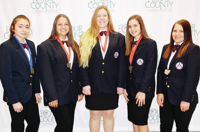 "Five students from Four County Career Center in Archbold placed in the top three in the 2019 Health Occupations Students of America (HOSA) State Conference in Columbus. They have now qualified to compete in the HOSA International Leadership Conference with the theme ""Define Your Purpose,"" June 19-22 in Orlando, Fla. The FCCC students will join other HOSA students from across the nation to participate in national-level skill competitions, workshops, and general sessions. Students competing are, from left, Angela Macias of Defiance, Emily Pippin of Liberty Center, Faith Rupp of Edgerton, Kyla Karzynow of Fairview, and Tunyshia DeWitt of Bryan. Advisors are Donna Badenhop, Robin Hill, Karen Walker, and Mike Nye."