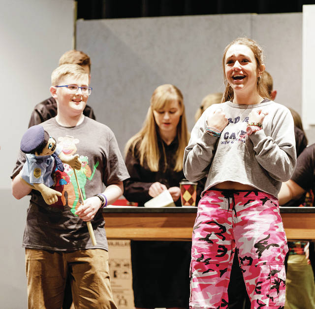 "Sydney Schauwecker rehearses with cast members for the stage production of ""Freaky Friday,"" to be presented this weekend at Delta High School."