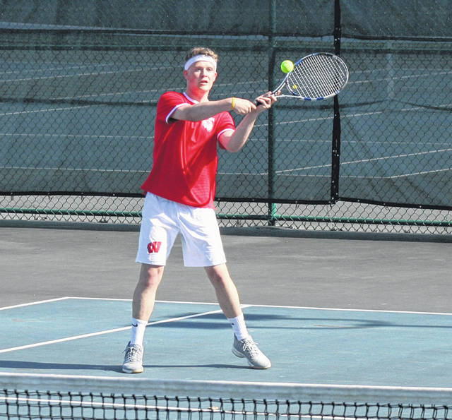 Brandon Krutz of Wauseon backhands one in his third singles match with Cameron Collins of Archbold during boys tennis action Tuesday. The Indians swept all three singles matches as they took down the Blue Streaks 3-2.