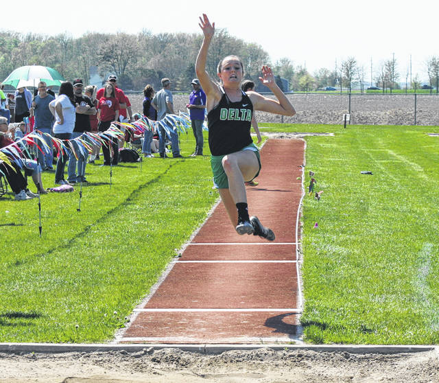 Cassandra Lee of Delta competes in the long jump during the NWOAL Track and Field Championships last May. She returns for her senior season.