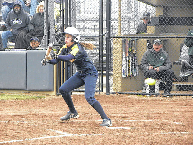 Gabby Nafziger attempts to bunt her way on base for Archbold in its win against Tinora Friday. The Blue Streaks shut out the Rams 2-0.