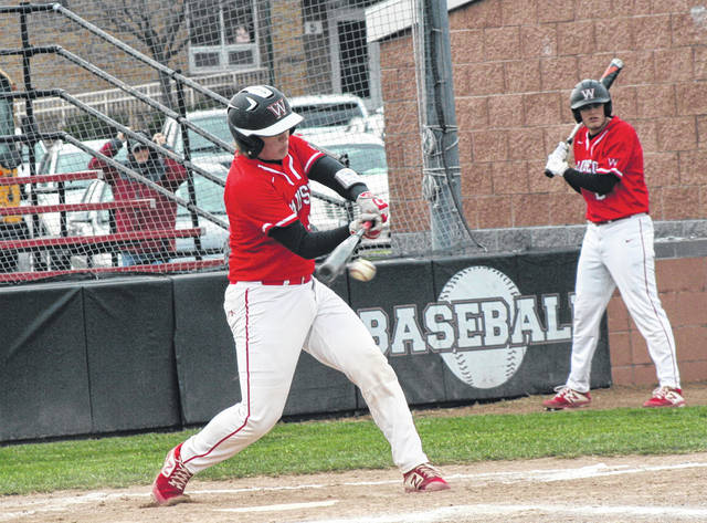 Sam Krasula of Wauseon with a base hit Thursday against Liberty Center. The Tigers scored five runs in the seventh to come back and defeat the Indians, 6-4.