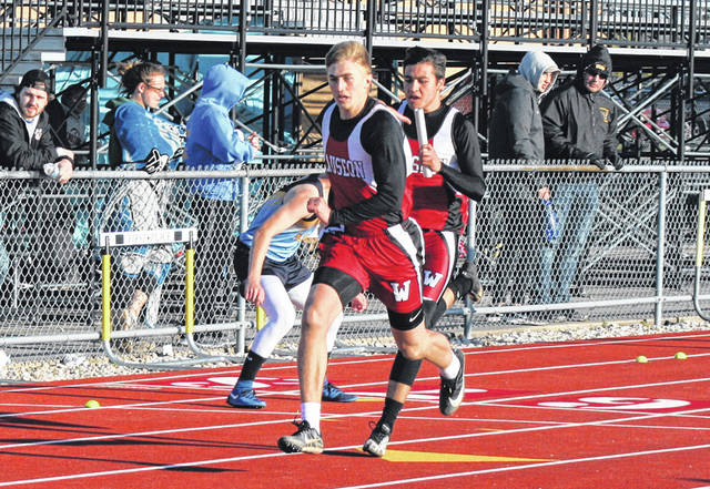 Wauseon's Noah Sauber takes a handoff from Noah Tester in the 4x100 meter relay during the Walker/Dilbone Relays in Archbold Friday. The Indians took third in this event as their boys placed third overall and the girls were fourth.