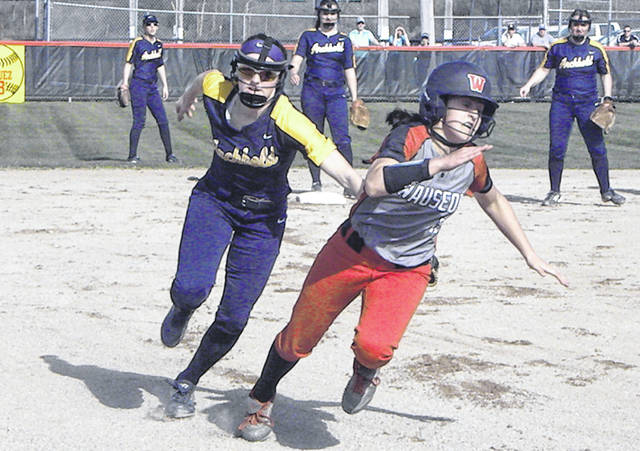 Kylie Sauder of Archbold tags out Wauseon's Autumn Pelok, but after a run had already scored on the play during a NWOAL softball contest Monday. The Indians bested their rival to the west, 12-5.