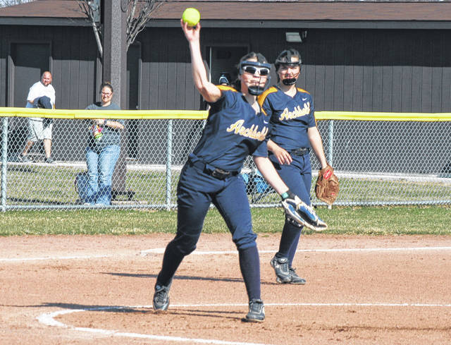 Archbold pitcher Chloe Schramm fields her position and throws over to first for an out during Monday's NWOAL softball opener versus Bryan. The Blue Streaks defeated Bryan by a 9-7 final.
