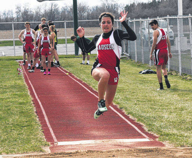 Wauseon's Paige Allison Smith in the long jump Tuesday at Evergreen during a NWOAL tri-meet with the Vikings and Archbold. She was first with a leap of 15 feet, 5 and 3/4 inches.